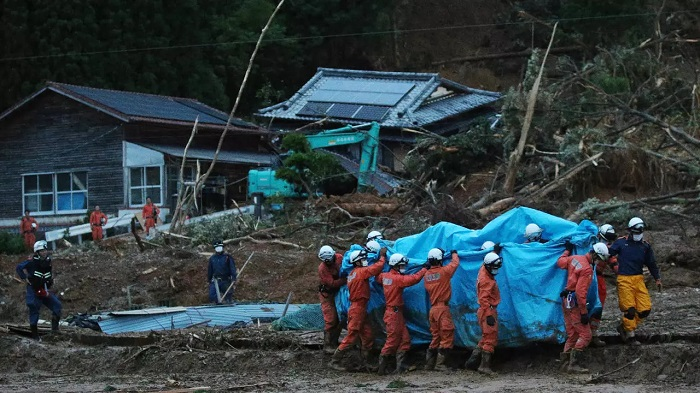 Rescue workers were trying all night to reach people cut off by the flooding JIJI PRESS/AFP