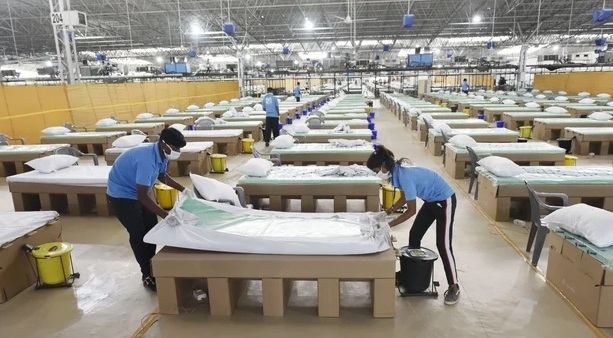 Cardboard beds being prepared at a Covid-19 hospital in New Delhi, India