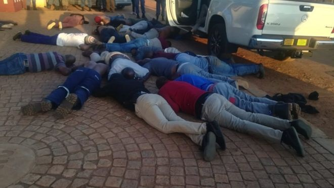 Police released images of suspects lying on the ground | SAPS