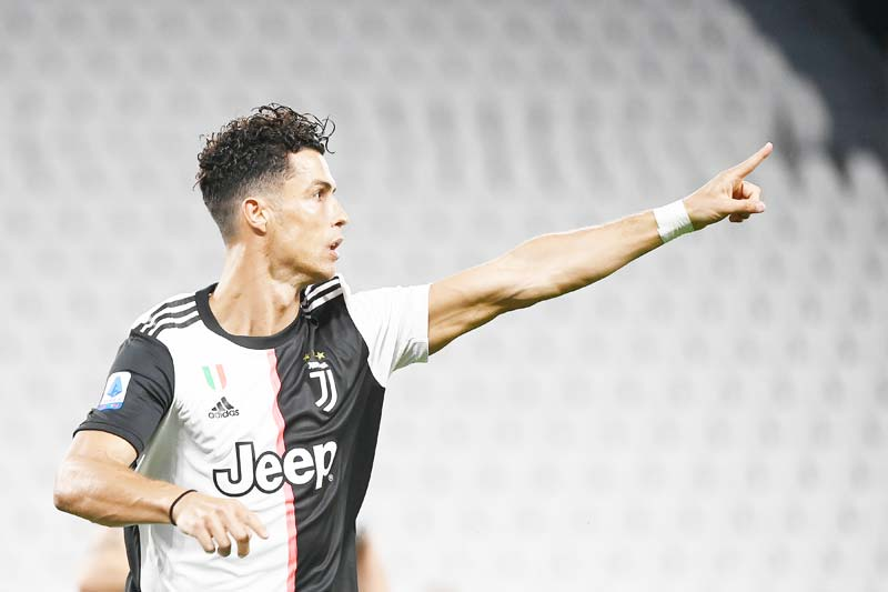 Juventus' Portuguese forward Cristiano Ronaldo celebrates after scoring a goal during the Italian Serie A football match between Juventus and Lazio, on July 20, 2020 at the Allianz stadium, in Turin, northern Italy.photo: AFP