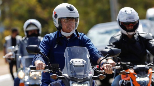 Brazil's President Jair Bolsonaro arrives at the Alvorada Palace on a motorcycle, amid the Covid-19 outbreak, in Brasilia, on July 25, 2020. Photo: Reuters