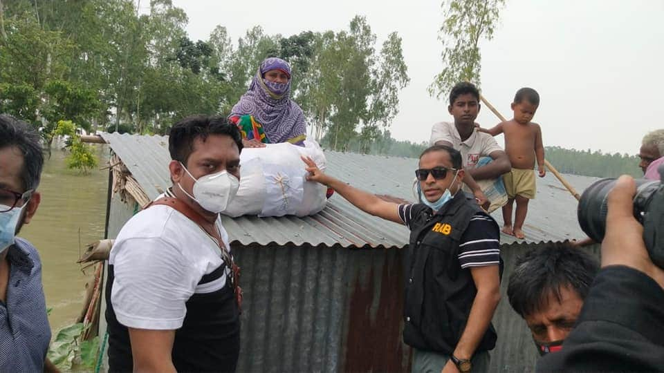 RAB-12 provides relief among 1,000 flood-hit people in Sirajganj