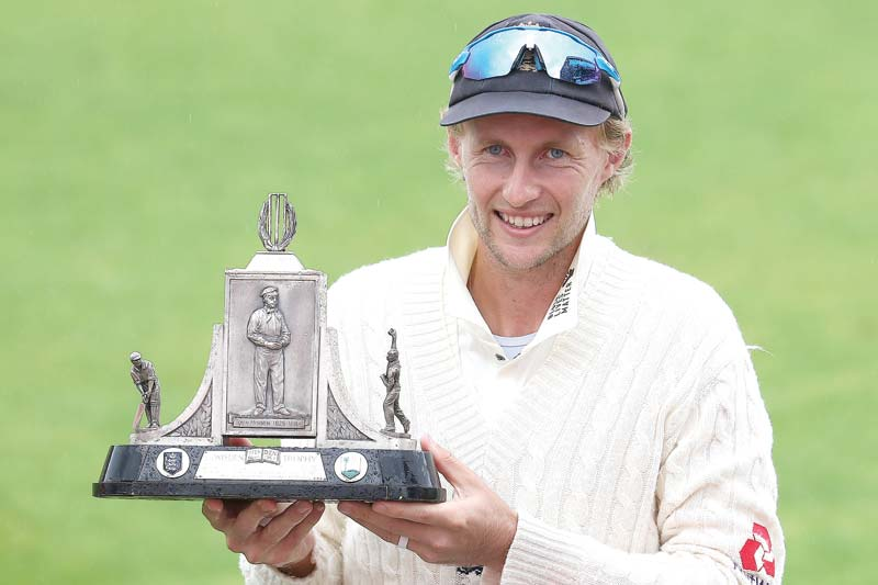 England's captain Joe Root holds aloft the Wisden Trophy after England won the Test series 2-1 against the West Indies, at the end of the final day of the third Test cricket match between England and the West Indies at Old Trafford in Manchester, northwest England on July 28, 2020. - England beat the West Indies by 269 runs on Tuesday to claim the third Test at Old Trafford and clinch the series. England took the series 2-1 to regain the Wisden Trophy they lost in the Caribbean last year. 	photo: AFP