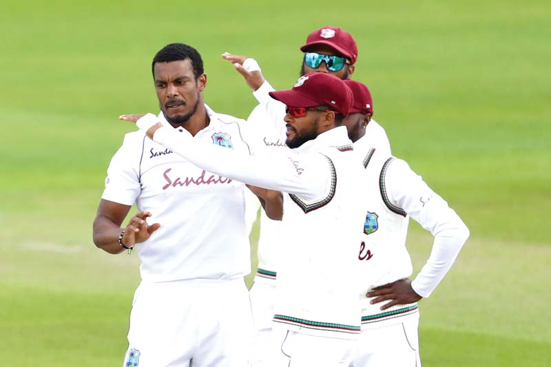 West Indies' Shannon Gabriel (L) is congratulated by team-mates after bowling out England's Ollie Pope on the second day of the third Test cricket match  at Old Trafford in Manchester, northwest England on July 25, 2020.	photo: AFP