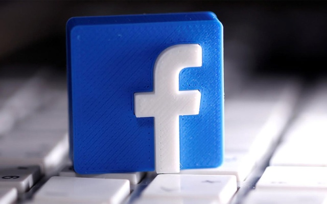 A 3D-printed Facebook logo is seen placed on a keyboard in this illustration taken March 25, 2020. Photo: Reuters