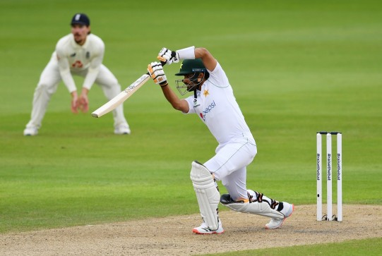 Elegant fifty - Pakistan's Babar Azam drives on the first day of the first Test against England at Old Trafford.  Photo: AFP