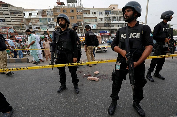 Police officers guard at the cordoned site after, according to police a grenade attack was carried out on a rally by the supporters of religious and political party Jamaat-e-Islami (JI) to mark the