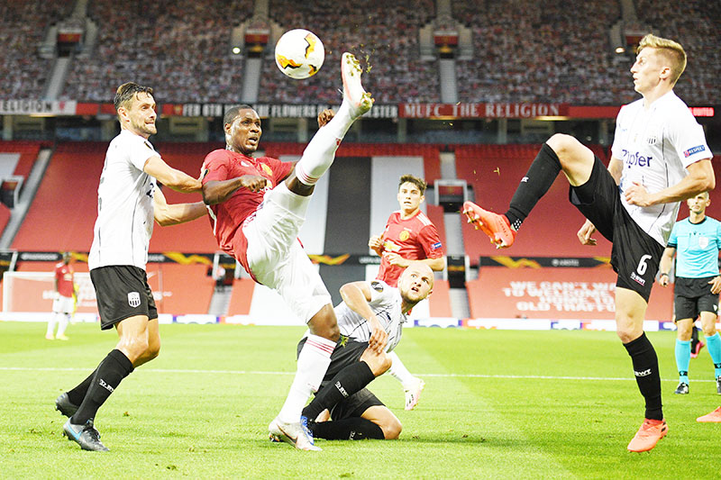 Manchester United's Nigerian striker Odion Ighalo (C) hooks the ball away during the UEFA Europa League last 16 second leg football match between Manchester United and Linzer ASK at Old Trafford in Manchester, north west England, on August 5, 2020.	photo: AFP