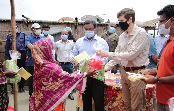 US Ambassador Earl Miller seen with flood-affected people at Madhya Khatiamari village in Gaibandha district on Saturday. They receive emergency relief from a U.S. government-funded program.