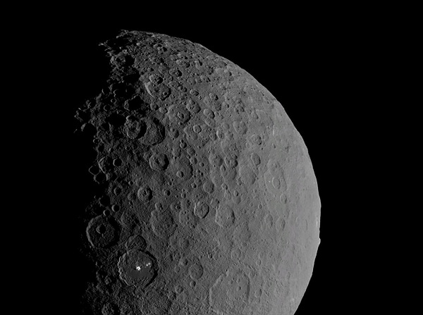Occator Crater and Ahuna Mons appear together in this view of the dwarf planet Ceres obtained by NASA's Dawn spacecraft on February 11, 2017. Photo: Reuters