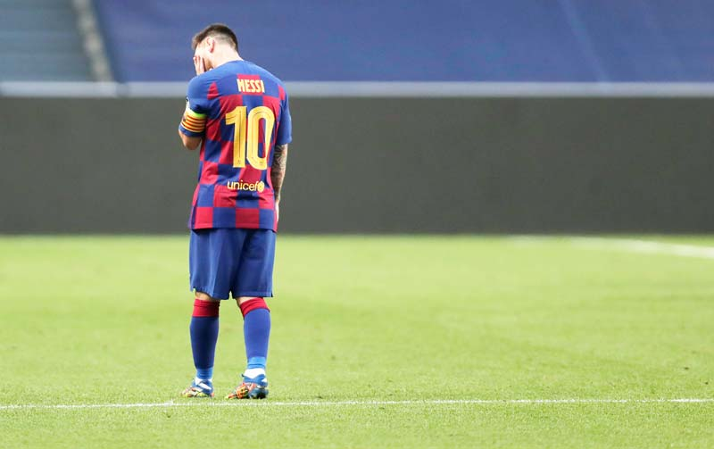 Barcelona's Argentinian forward Lionel Messi reacts after Bayern Munich's second goal during the UEFA Champions League quarter-final football match between Barcelona and Bayern Munich at the Luz stadium in Lisbon on August 14, 2020.photo: AFP