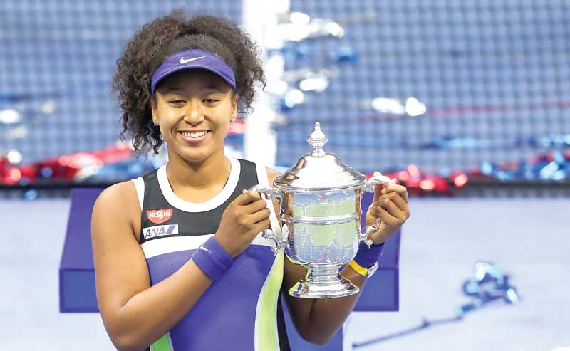 Naomi Osaka of Japan celebrates with the trophy after winning her Women's Singles final match against Victoria Azarenka on September 12, 2020 in the Queens borough of New York City.  photo: AFP