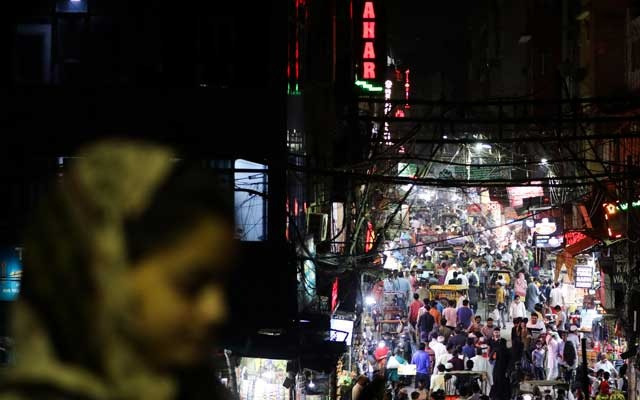 People are seen in a crowded street amidst the spread of the coronavirus disease (COVID-19), in the old quarters of Delhi, India, Sept 13, 2020. Photo: Reuters
