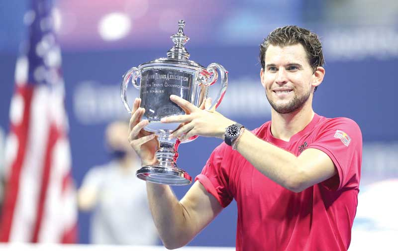 Dominic Thiem of Austria celebrates with championship trophy after winning in a tie-breaker during his Men's Singles final match against Alexander Zverev of Germany on Day Fourteen of the 2020 US Open at the USTA Billie Jean King National Tennis Center on September 13, 2020 in the Queens borough of New York City. photo: AFP