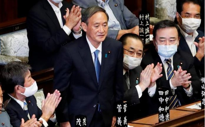 Japan's Suga formally voted in as PM, readies 'continuity cabinet'