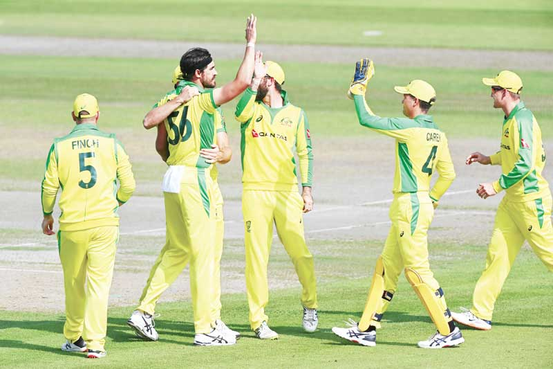 Australia's Mitchell Starc (2L) celebrates taking the wicket of England's Joe Root lbw for 0 runs during the one-day international (ODI) cricket match between England and Australia at Old Trafford in Manchester on September 16, 2020.photo: AFP
