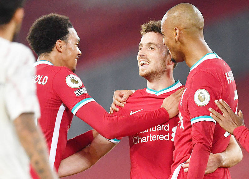 Liverpool's Portuguese striker Diogo Jota (C) celebrates scoring his team's third goal during the English Premier League football match between Liverpool and Arsenal at Anfield in Liverpool, north west England on September 28, 2020.photo: AFP