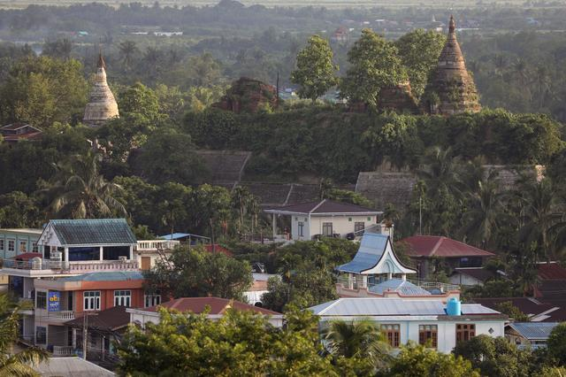 A landscape view of the downtown with ancient pagodas in the background in Mrauk U, Rakhine state, Myanmar June 28, 2019. Photo: /Ann Wang