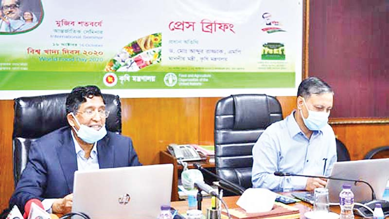Agriculture Minister Dr Abdur Razzak (left) flanked by Agriculture Secretary M Nasiruzzaman, speaking at a press briefing at his Secretariat office on Saturday.