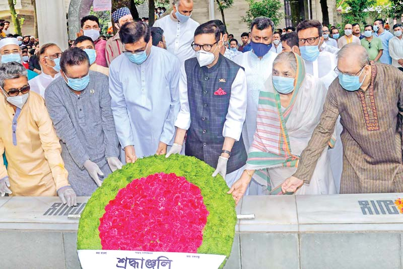 Awami League General Secretary Obaidul Quader along with party leaders placing a wreath on the grave of Shaheed Sheikh Russel, the youngest son of Father of the Nation Bangabandhu Sheikh Mujibur Rahman, marking his 57th birthday at the Banani Graveyard in the capital on Sunday.photo: observer