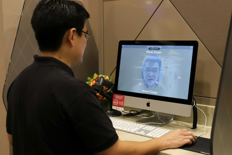 Singapore will become the world's first country to use facial verification in its national ID scheme.