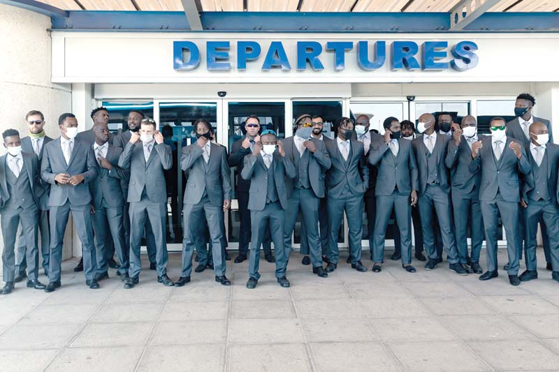 The Zimbabwe cricket squad of 20 players pose for pictures as they depart the country at Robert Mugabe International Airport in Harare on October 19, 2020 , after having spent seven days in a bio-secure bubble as a preventive measure against the spread of the COVID-19 coronavirus ahead of their tour of Pakistan. 	photo: AFP