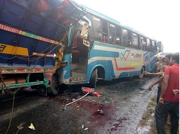 Man killed in bus-truck collision