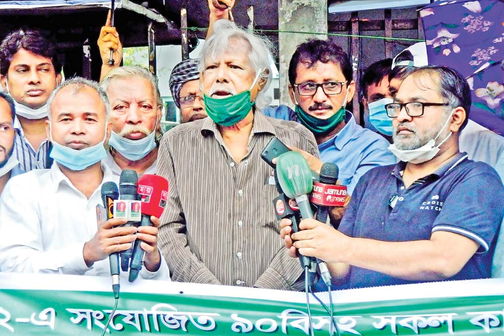 Gonoshasthaya Kendra founder Dr Zafrullah Chowdhury speaking at a sit-in programme in front of the National Press Club organized by Rajnoitik Daler Nibandhan Podhati Batiler Dabi Parishad 'the parishad for scrapping registration system of political parties' on Friday. The platform arranged the programme demanding steps to cancel all 'black laws', including section 90 added to the RPO, and the reconstitution of the Election Commission.  	photo: observer