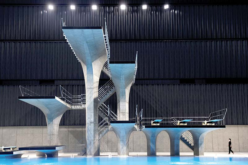 This picture shows diving platforms of Tokyo Aquatics Centre, a venue for swimming, diving and artistic swimming of the 2020 Tokyo Olympics and Paralympics Games, during its opening ceremony in Tokyo on October 24, 2020.	photo: AFP