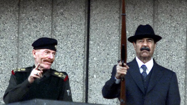 Late Iraqi president Saddam Hussein (R) and the vice president of the ruling Revolutionary Command Council, Izzat Ibrahim al-Duri, salute a December 2000 military parade in Baghdad AFP/File
