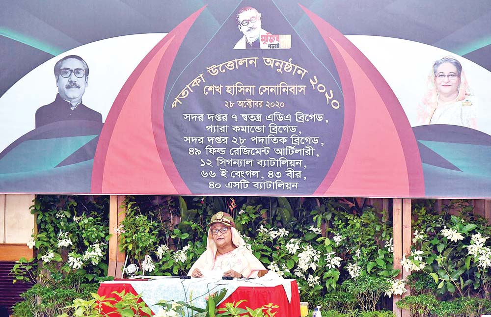 Prime Minister Sheikh Hasina delivering speech virtually from her official residence Ganobhaban in a programme of raising flags of eight units and organisations of Bangladesh Army at Sheikh Hasina Cantonment, Lebukhali in Patuakhali on Wednesday. 	PHOTO: PID