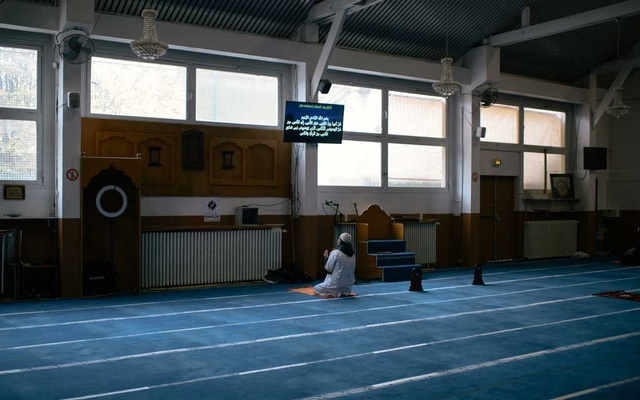 """A man prays in the mosque in Ivry-sur-Seine, a working-class suburb east of Paris, France on Oct. 27, 2020. French officials' attack on """"Islamic separatism"""" and the """"enemy within"""" has mainstream Muslims questioning whether they will ever fully integrate. (Dmitry Kostyukov/The New York Times)"""