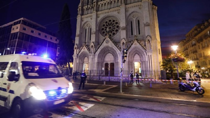 A Police vehicle passes by the Notre-Dame de l'Assomption Basilica in Nice on October 29, 2020 after a knife-wielding man kills three people at the church, slitting the throat of at least one of them, in what officials are treating as the latest jihadist attack to rock the country. (AFP)