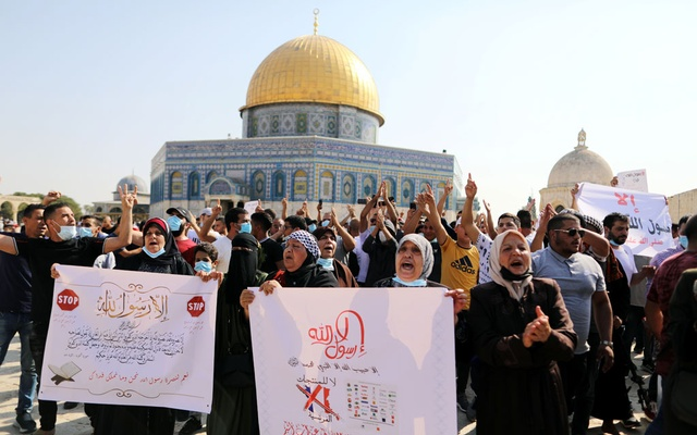 Palestinians protest against the publications of a cartoon of Prophet Mohammad in France and French President Emmanuel Macron's comments, following Friday prayers on the compound known to Muslims as Noble Sanctuary and to Jews as Temple Mount in Jerusalem's Old City October 30, 2020. Reuters