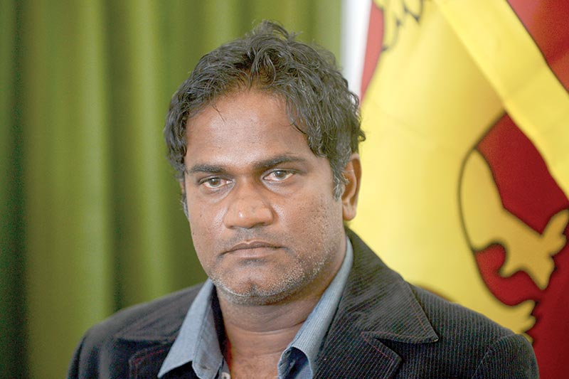 Former Sri Lankan cricket bowling coach and fast bowler Nuwan Zoysa attends a press conference in Colombo on November 20, 2020. - Zoysa on November 20 accused the International Cricket Council (ICC) of prematurely declaring him guilty of match-fixing and vowed to defend his innocence. photo: AFP