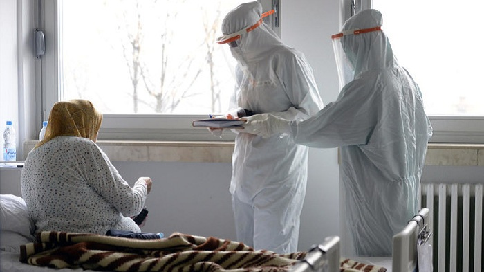 A doctor and nurse take care of patients with COVID-19 at a former military hospital in the capital Sarajevo, Bosnia, Thursday, Nov. 19, 2020. (AP)