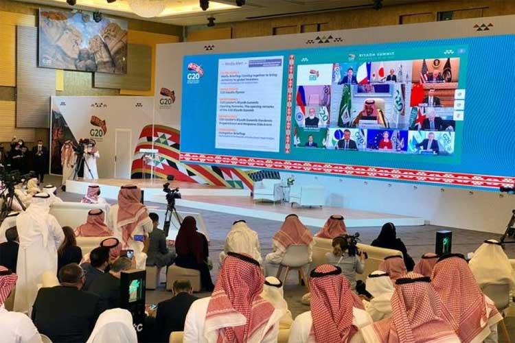 Media watches Saudi King Salman bin Abdulaziz's virtual speech live at the media centre during an opening session of the 15th annual G20 Leaders' Summit in Riyadh, Saudi Arabia November 21, 2020. REUTERS/Nael Shyoukhi