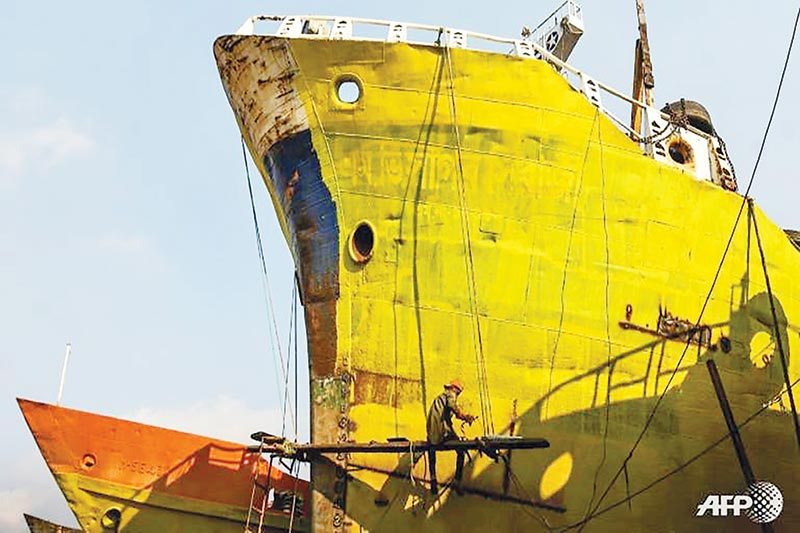 A worker painting a ship at Char Kaliganj yard in Gazipur district.