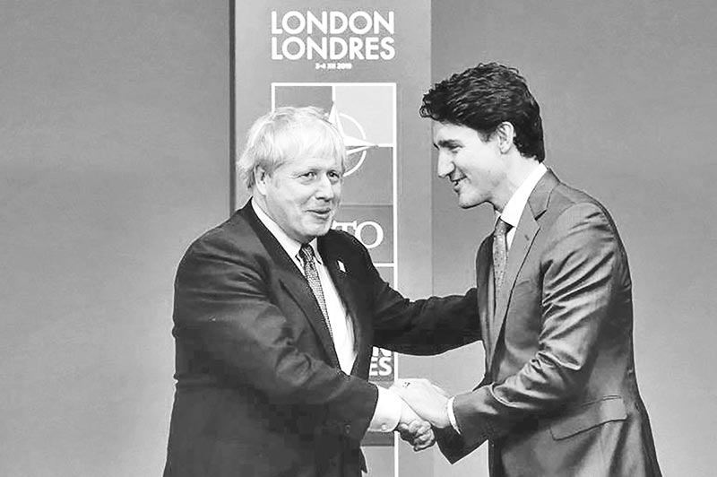 Britain's Prime Minister Boris Johnson (L) shakes hands with Canada's Prime Minister Justin Trudeau at a NATO summit last year.	photo : AFP