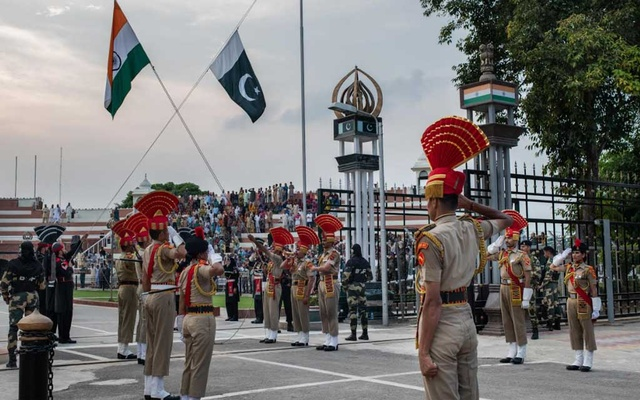 Members of India's Border Security Force, foreground, at the daily flag-lowering ceremony with their Pakistani counterparts, in black uniforms, at the Wagah-Attari border crossing, Sept 19, 2019. The New York Times
