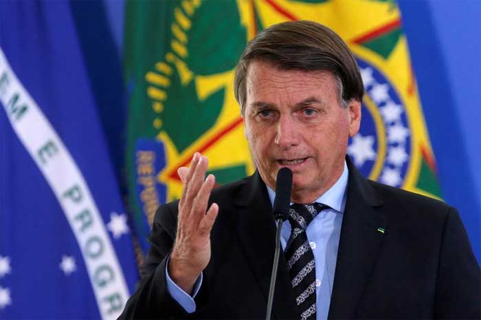 Brazil's President Jair Bolsonaro speaks during a ceremony at the Planalto Palace in Brasilia, Brazil November 26, 2020. REUTERS/Adriano Machado