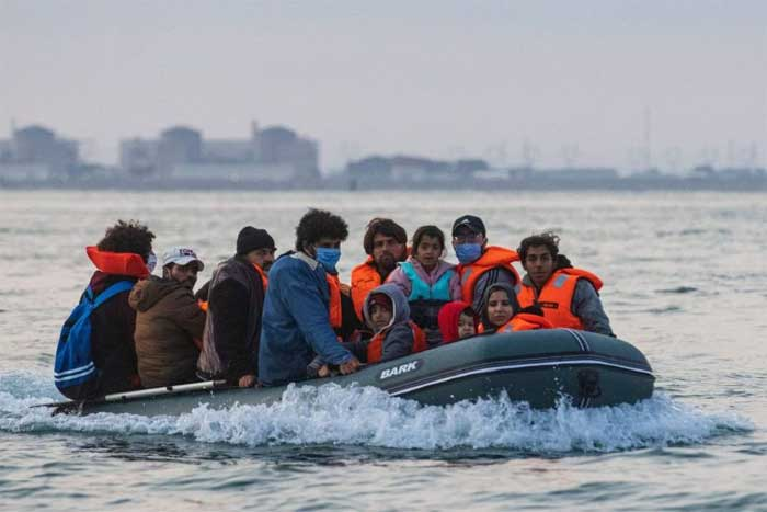 Kuwaiti migrants sit in a dinghy as they illegally cross the English Channel from France to Britain on Sept 11, 2020.PHOTO: AFP