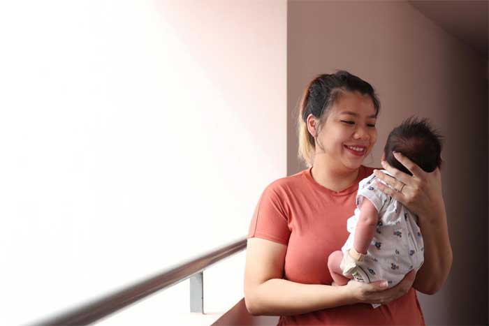 Mrs Celine Ng-Chan and her two week old son Aldrin Zaccheus Chan. ST PHOTO: TIMOTHY DAVID