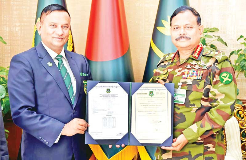 Bangladesh University of Professionals (BUP) Vice Chancellor Major General Ataul Hakim Sarwar Hasan handing over the PhD certificate to Chief of Army Staff General Aziz Ahmed on Sunday on the campus.photo : ISPR