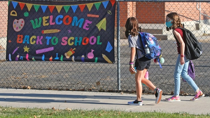 School children arrive at Liberty Elementary School on the first day of class Monday in Murray, Utah [AP Photo/Rick Bowmer]