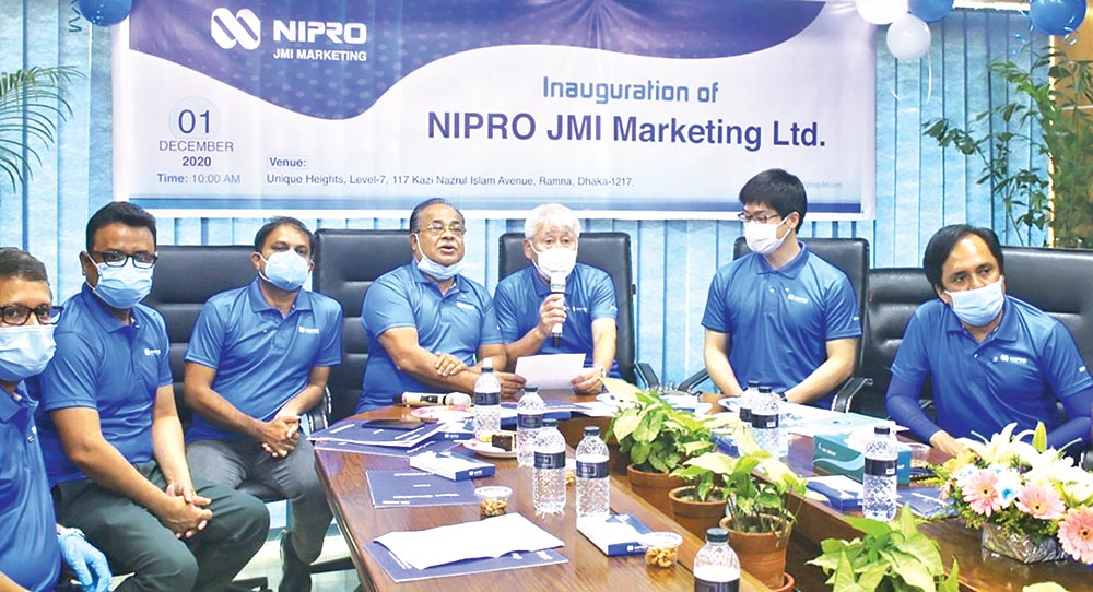 NIPRO Asia Pte Ltd representative Shigetomi Hisao speaks as JMI Group Managing Director Md Abdur Razzaq looks on at  the launching ceremony of NIPRO JMI Marketing Ltd at JMI Group's head office at the capital's Banglamotor area on Tuesday morning.
