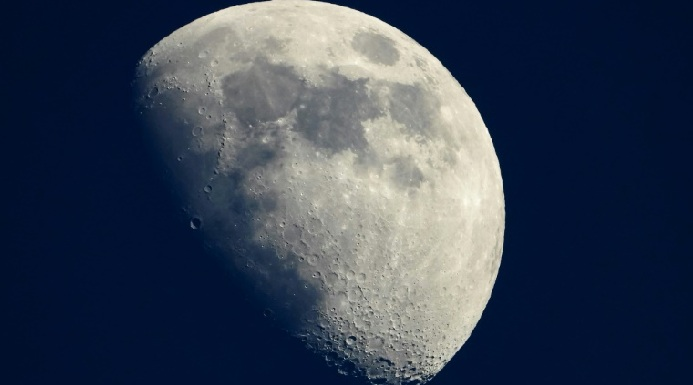Nasa has awarded contracts to four companies to collect lunar samples.
