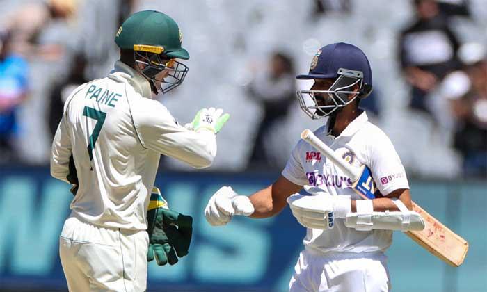 Australian captain Tim Paine, left, congratulates Indian captain Ajinkya Rahane after winning the second cricket test at the Melbourne Cricket Ground, Melbourne, Australia on Tuesday. — AP