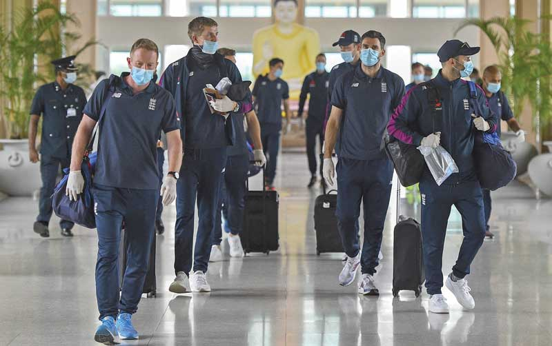 England�s cricket team arrive at the Rajapaksa international airport in Mattala on January 3, 2021, as the team returned to Sri Lanka to play two Tests abandoned in March due to the Covid-19 coronavirus pandemic. photo: AFP