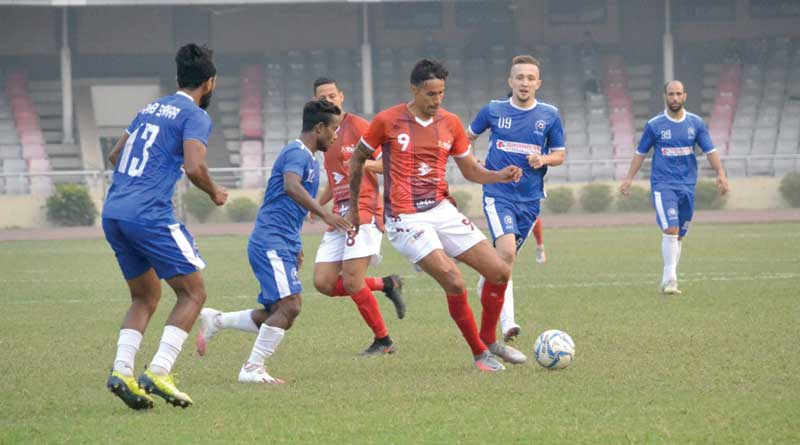 Bashundhara Kings Argentine striker Ra�l Becerra tackling the ball while players of Uttar Baridhara chasing him in the opening match of the Bangladesh Premier League on Wednesday at the Bangabandhu National Stadium in Dhaka.	photo: BFF